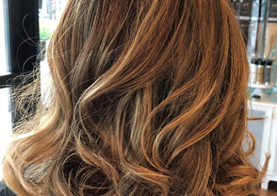 Balayage, layered cut and soft waves by Rachel
